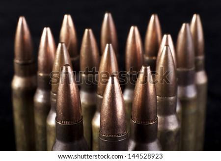 Bullets closeup on black backgrounds - stock photo