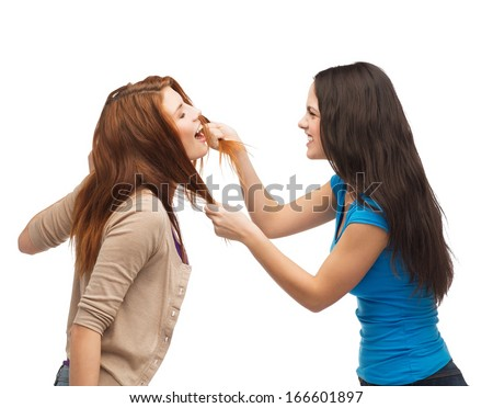 bullying, friendship and people concept - two teenagers having a fight and getting physical - stock photo