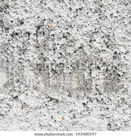 Bumpy old concrete wall fragment as a grunge background texture - stock photo