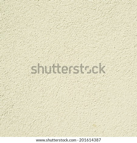Bumpy painted wall fragment as a background texture - stock photo