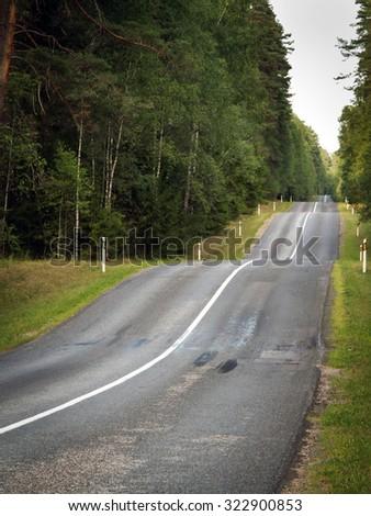 Bumpy road - stock photo