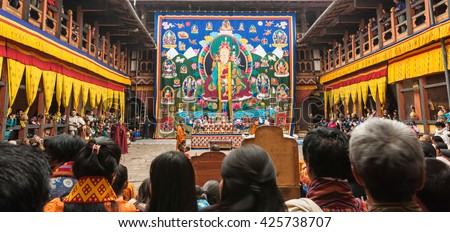 Bumthang, Bhutan, 06 Nov 2011: A thangka scroll painting hangs on display at the tsechu festival at Jakar Dzong. Festival is open to public for free. - stock photo