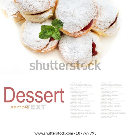 Bun with jam and icing sugar coating on white background - stock photo