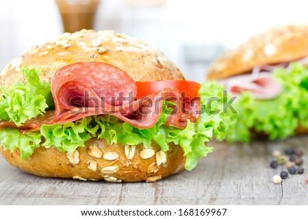 bun with salami - stock photo