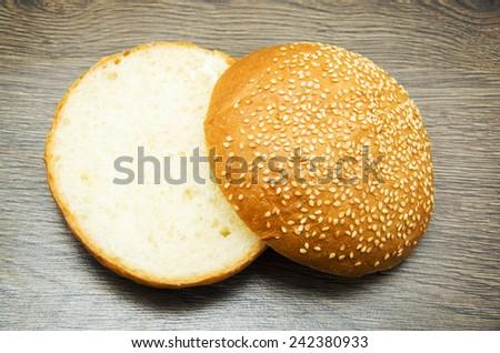 bun with sesame seeds - stock photo