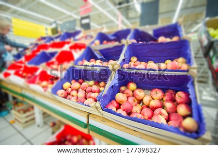 Bunch of apples in wood boxes in supermarket - stock photo