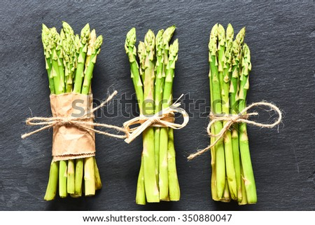 Bunch of asparagus over slate background - stock photo