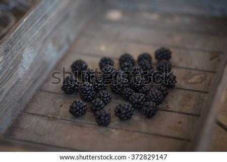 bunch of backberries in a wooden basket - stock photo