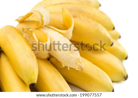 Bunch of bananas with open one isolated on white. - stock photo