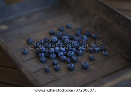 bunch of blueberries in a wooden basket - stock photo