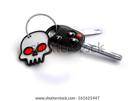bunch of car keys with skull key ring. Great symbol for reckless, irresponsible, drunk driving. Also a nice symbol to use for drive safe on halloween - stock photo