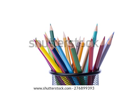 Bunch of color pencils in a stand over the white background, isolated - stock photo