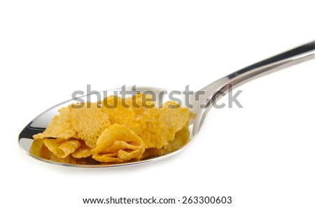 Bunch of corn flake cereals on a metal spoon. Breakfast concept - stock photo