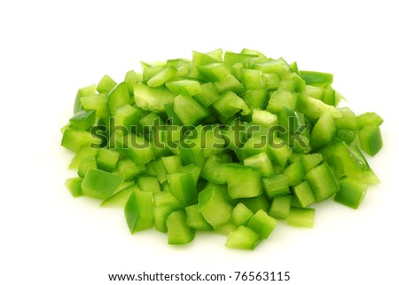bunch of cut pieces of green paprika (capsicum) on a white background - stock photo