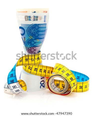 Bunch of Euro notes tied together with a tape measure. - stock photo