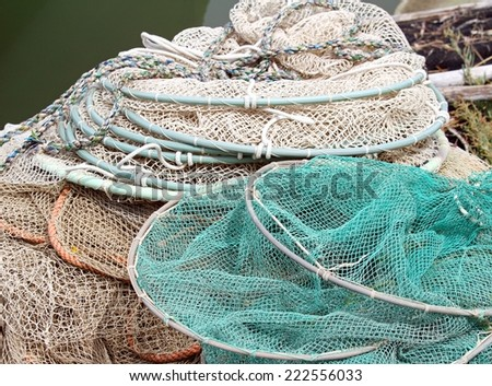 bunch of fishing nets of fishermen just returned to the naval port - stock photo