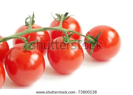 bunch of fresh cherry tomato on white background - stock photo