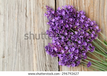 Bunch of fresh lavender flowers on a wooden background. - stock photo