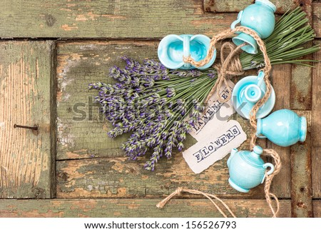 bunch of fresh lavender flowers over rustic wooden background - stock photo
