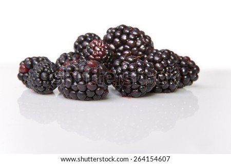 Bunch of fresh ripe blackberries. Isolated over on white background - stock photo