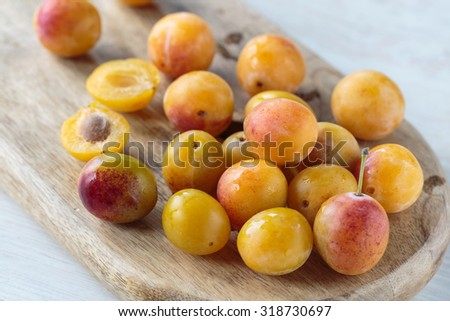 Bunch of fresh sweet Mirabelle plums - stock photo