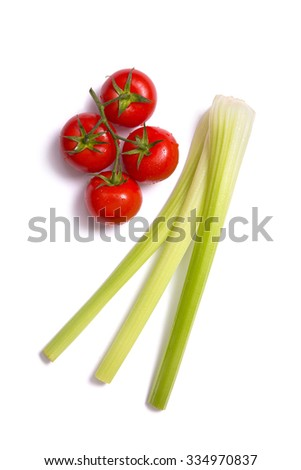 Bunch of fresh tomatoes and celery sticks, top view isolated on white background  - stock photo