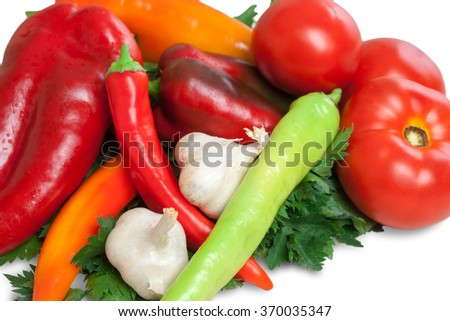 Bunch of fresh vegetables isolated on white. Tomato, parsley, chilli pepper, pepper and garlic on a pile. - stock photo