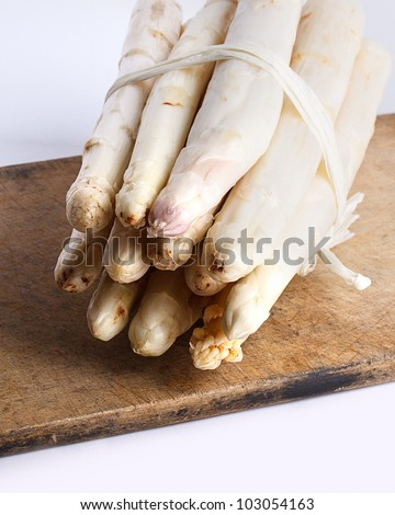 Bunch of fresh white asparagus spears ready to be used as an ingredient in cooking - stock photo