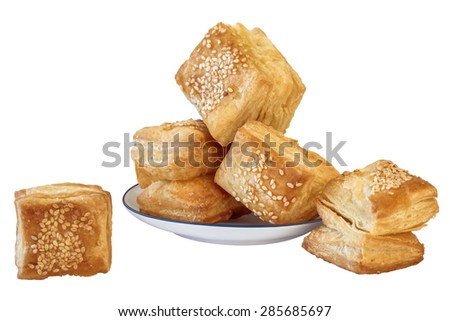 Bunch of Freshly Baked Serbian Small Square Shaped Croissant Puff Pastries Zu-Zu, with its Crispy Golden Crust Sprinkled with Sesame Seeds, Isolated on White Background. - stock photo