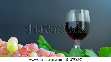 bunch of grape and a glass of red wine - stock photo