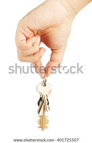 Bunch of keys in hand - stock photo