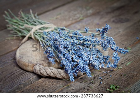 Bunch of lavender flowers on an old wood table  - stock photo
