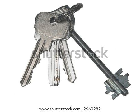 Bunch of metal modern keys on a ring, isolated on white - stock photo
