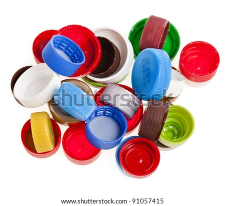 Bunch of multicolored used plastic  bottle caps on white background - stock photo