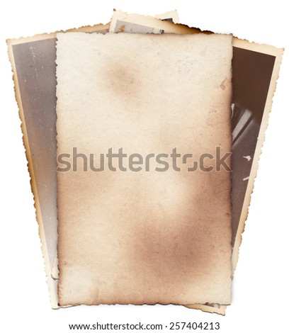 Bunch of old photos with stains, scratches and burned edges isolated - stock photo