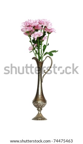 Bunch of pink flowers inside ancient metal vase. Isolated on white with clipping path - stock photo