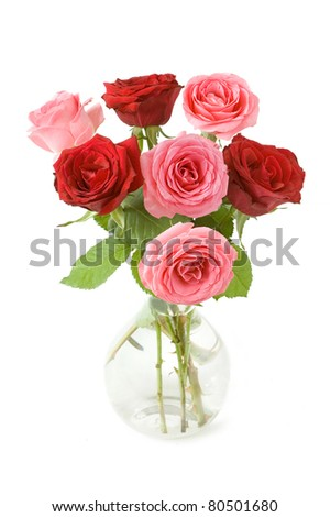 Bunch of red and pink roses in vase isolated on white - stock photo