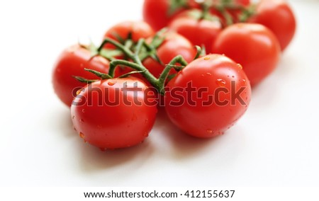 Bunch of red tasty fresh tomatos on the white background.  - stock photo