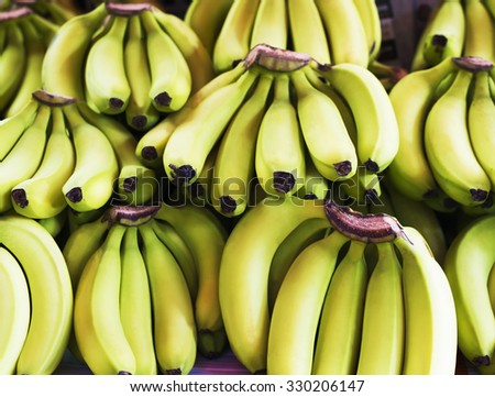Bunch of ripened bananas at grocery store - stock photo