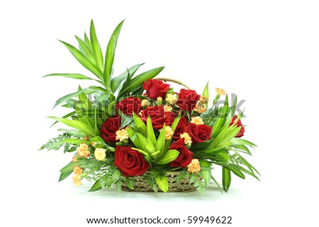 Bunch of rose flowes in a basket - stock photo