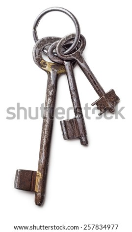 Bunch of scratched and aged antique iron door keys with ring isolated on white background. - stock photo