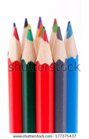 Bunch of sharpened wooden colourful pencil crayons in the colours of the spectrum or rainbow on a white background symbolising art and creativity - stock photo