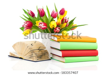 bunch of spring tulips and books, isolated on white background - stock photo