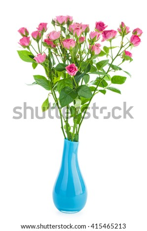 Bunch of tiny pink roses in a blue ceramic vase isolated on white background - stock photo