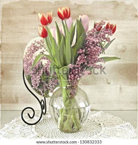 bunch of tulips and mimosa in vase, vintage stylized - stock photo