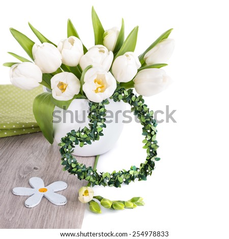 Bunch of white tulips and matching spring decorations on wood isolated on white. Can be used as corner decoration for Easter, March 8 or Mother's day designs or wedding invitations. Text space. - stock photo