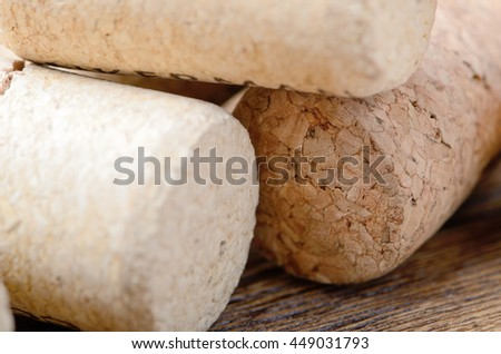 Bunch of wine corks on wooden table - stock photo