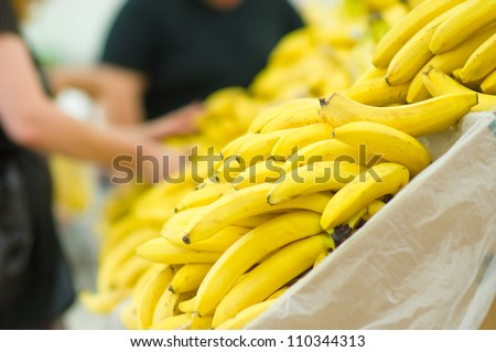 Bunch of yellow and green bananas in supermarket - stock photo
