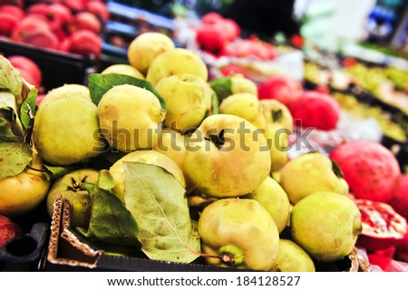 Bunch of yellow quince in supermarket. Wide angle shot - stock photo