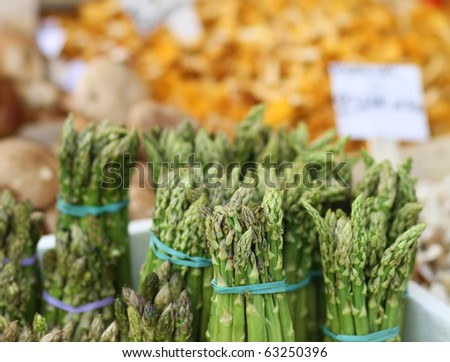 bunches of asparagus at the farmer's market - stock photo
